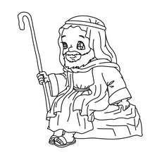 Heiliger Joseph sitzt bei der Krippe zum Ausmalen