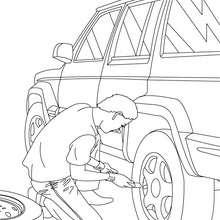 Mechaniker wechselt ein Rad zum Ausmalen
