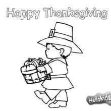 Pilgerjunge mit einem Thanksgiving Korb