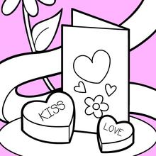 Valentinsgrußkarte und Pralinen